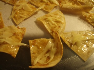 Spread the tortillas out on a platter to serve, and sprinkle on the grated cheese. These ones were still warm, so it melted, yay!